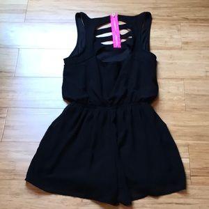 Fun black romper with electric pink zipper!